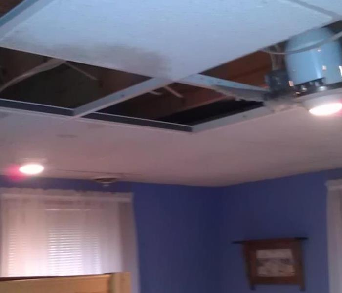 ROOF DAMAGE FROM STORM CAUSES MANY PROBLEMS Before